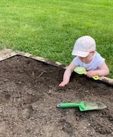 Child playing in the dirt
